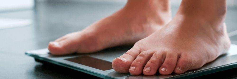 male feet on scale