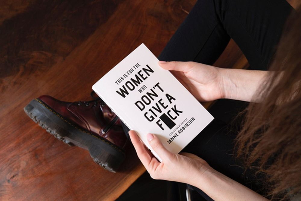 woman reading a sexist book