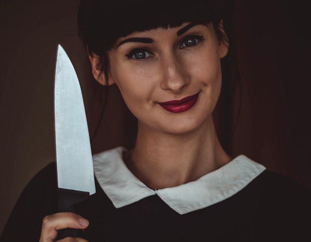 image of a woman holding a knife